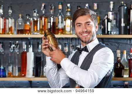 Handsome bartender during work