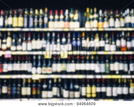 Blurred Wine Liquor Bottle On Shelf wholesale retail shop background