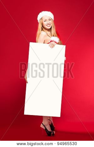 Santa woman pointing at blank whiteboard