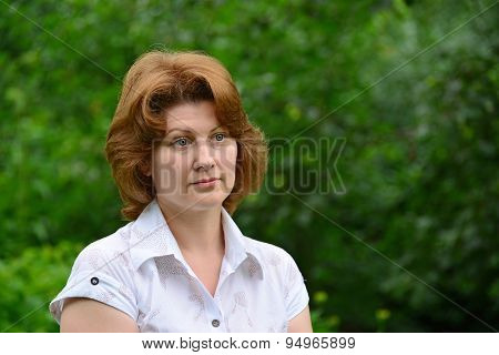 Portrait Of Woman On  Nature In The Summer