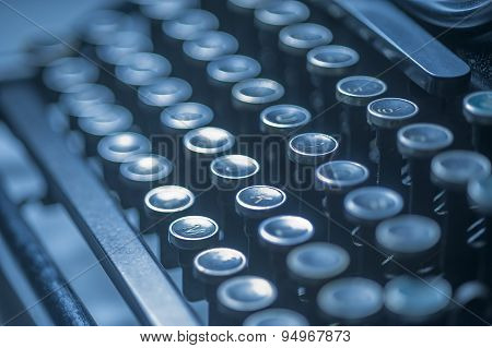 Old typewriter keys in blues