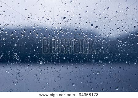 Rain Drops On A Window Or Water Drops On Glass Background