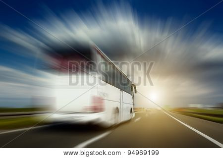 White Bus In Motion Blur Overtaking On The Highway