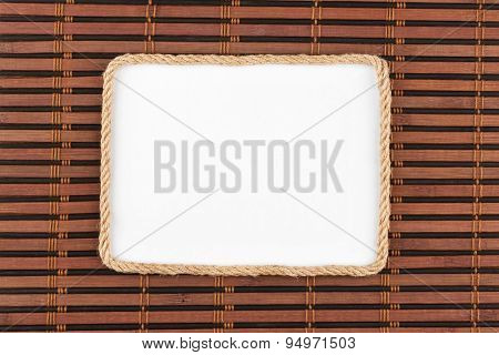 Frame Of Rope Lying On A Bamboo Mat With A White Background