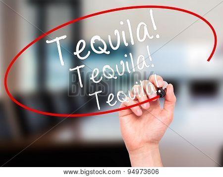 Man Hand writing Tequila with black marker on visual screen.