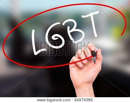 Man Hand writing LGBT Increase with black marker on visual screen.