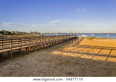 Algarve Cavacos Beach Footbridge And Seascape At Ria Formosa Wetlands Reserve, Southern Portugal.