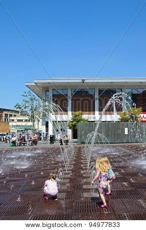 Toddlers playing in fountain, Liverpool.
