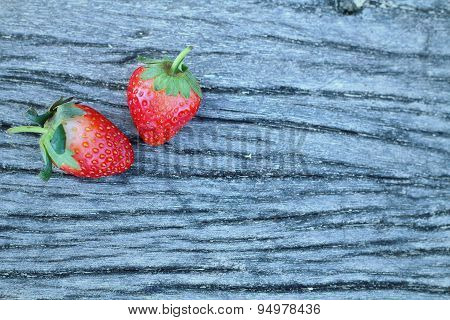 Red Strawberries On Wood Table