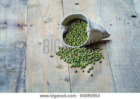 Mung Beans In Sack On Vintage Wooden Boards