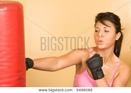 Women Exercising On Weightlifting Machine