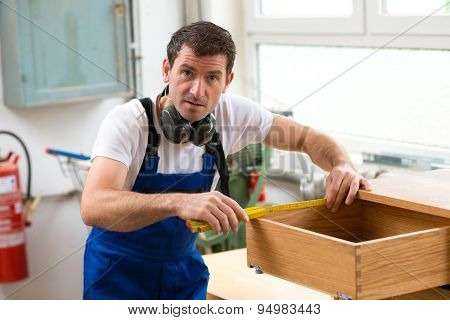 Worker In A Carpenter's Workshop