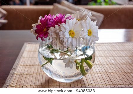 Bouquet Of Camomile Flowers In Glass Vase