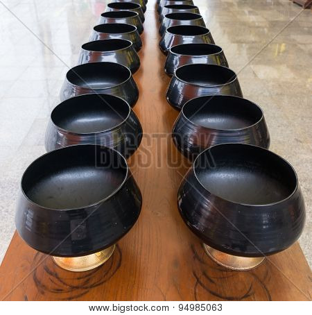 Monk's Alms-bowl On The Table In Thai Temple.
