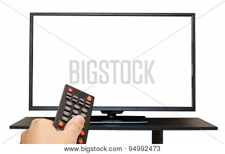 Hand holding remote control to the TV screen isolated on white background