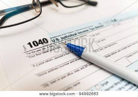Filling Individual tax return form 1040 on a table