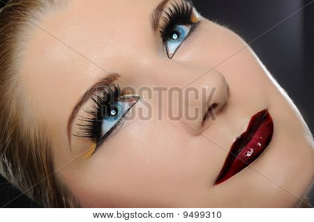 Fall Fashion Makeup Trend. Pretty Woman Face With Bright Make-up And Purple Lipstick