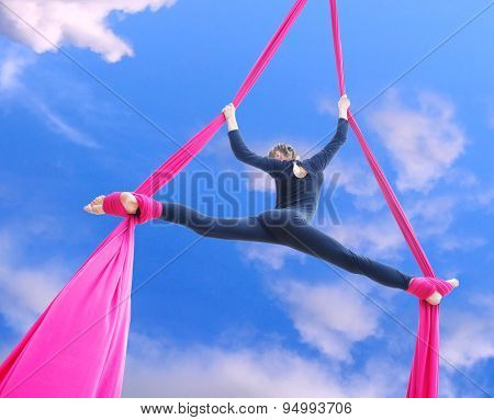 Cheerful Child Training On Aerial Silks In The Sky
