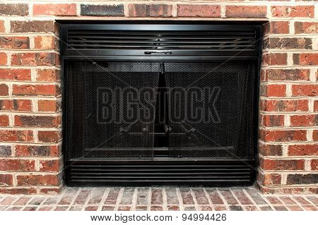 Fireplace with brick wall.