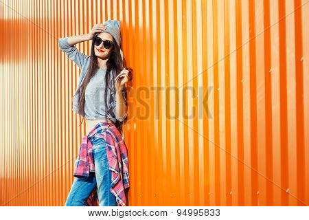 Beautiful Bool Girl Over Orange Wall
