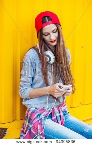 Young Girl Listens To Music In White Headphones
