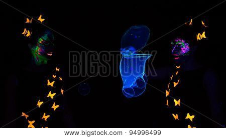 Photo of two women blowing luminous bubbles