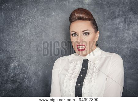 Scared Teacher Woman On The Blackboard Background