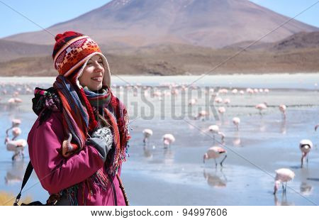 Happy woman travels in wild nature of Andes, Bolivia