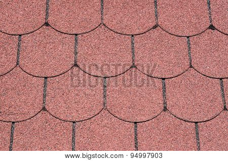 Roof With Red Bitumen Shingles Closeup