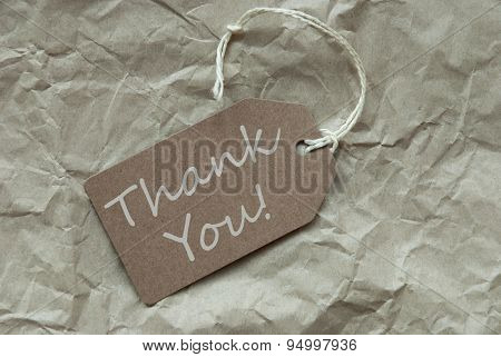 Beige Label With Thank You Paper Background