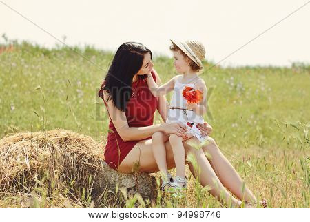 Mother And Daughter In Field
