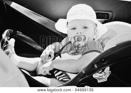 Baby Girl Sitting In Car