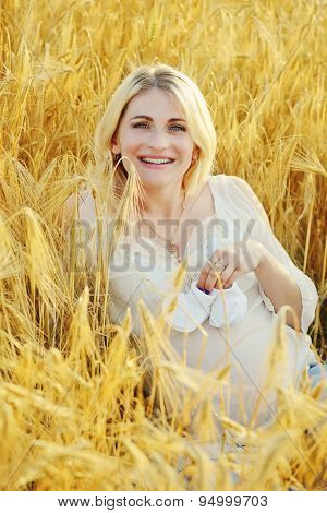 Pregnant Woman  In Wheat