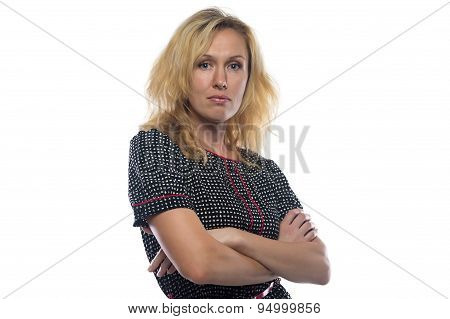 Photo of woman with blond hair, arms crossed