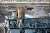 stock photo of spayed  - Water injection to minimize dust coal Industry - JPG
