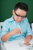 image of reagent  - Vietnamese boy working with reagent in the chemistry class - JPG