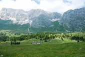 image of farm land  - The rural mountainous landscape of the Altiplano de Montasio in the Friulian Alps in north east Italy - JPG