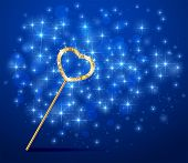stock photo of faerie  - Golden magic wand with heart on blue sparkle background - JPG
