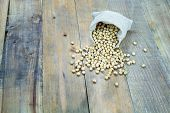 picture of soybeans  - Soybean in sack on vintage wooden boards still life - JPG