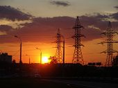 foto of paysage  - an urbanistic landscape at evening with a highway and power poles - JPG