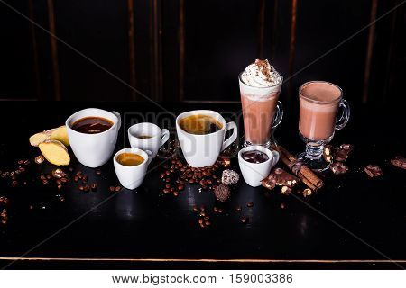 Different coffee cups on the table is decorated ukashenny