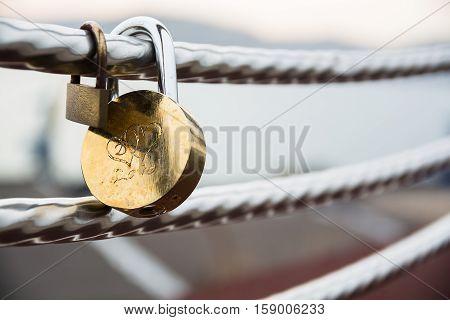 Wedding lock on a handrail. Symbol of marriage.