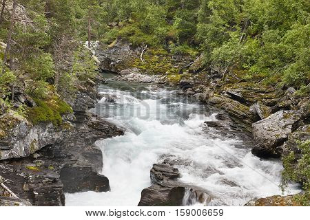 Norway landscape with forest mountains and Raume river. Andalsnes. Horizontal