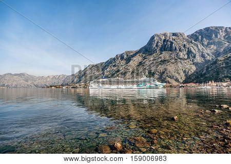 Kotor, Montenegro- November 6, 2016: Cruiser at port of Kotor in the early morning autumn