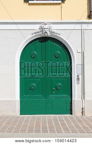 Renaissance style front door painted of green