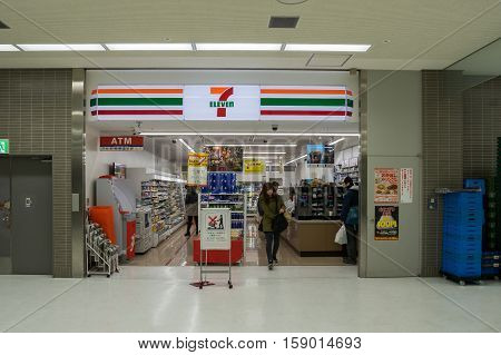 TOKYO, JAPAN - NOV 18, 2016 : Unidentified shopping in seven eleven in the Narita Airport on Nov 18,2016.