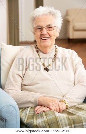 Senior Woman In Chair At Home