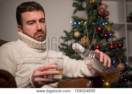 Man Feeling Lonely And Drinking Alcohol Alone