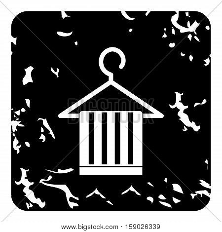 Scarf on a coat hanger icon. Grunge illustration of scarf on a coat hanger vector icon for web