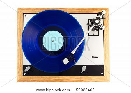 Vintage turntable, vinyl player with a blue vinyl disk on it, top view
